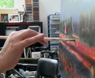 Al Currier painting in studio